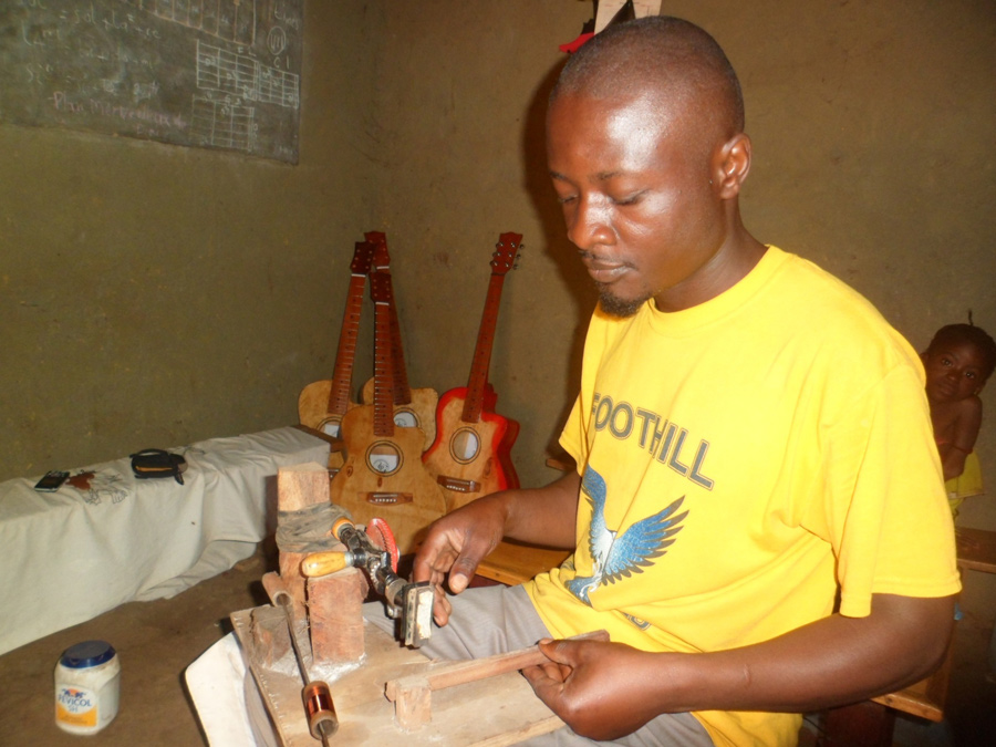 Guitar Maker at Dzaleka Refugee Camp, Malawi